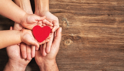 Family Hands Holding Hearts